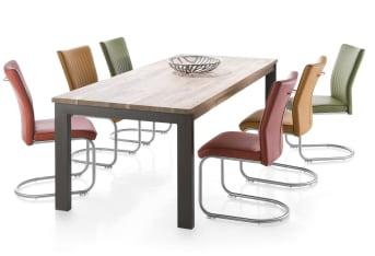 Cette table à manger de la collection Falster Henders & Hazel est disponible en deux dimensions. La plus petite version mesure 90 x 190 cm. L'éblouissant dessin dans le dessus de cette table en bois Kikar se combine à merveille avec les pieds en métal. Le dessus de table est traité à l'huile et à la fumée.