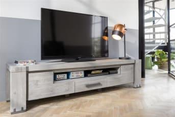 """Résolument pratique, ce meuble TV Avola saura vous combler jour après jour. Intégrant 2 portes rabattantes, un tiroir et une niche, ce <a href=""""/hh/meubles-de-rangement/meubles-tv/"""">meuble TV</a> avec rangement vous assure l'espace nécessaire pour stocker votre lecteur blu-ray et vos films préférés. L'effet patiné de ce meuble TV en fait par ailleurs un équipement au style authentique. Téléchargez notre catalogue !"""