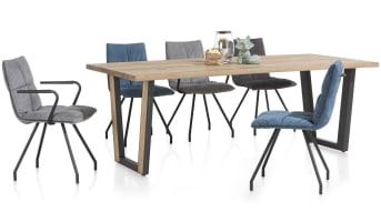 """Eettafel """"DENMARK"""" is een stoere eettafel met warme uitstraling door het mooie eiken houten tafelblad. """"DENMARK"""" heeft stevige u-vorm poten die wat taps toe lopen, voor een speelser en praktischer effect. Met zijn lengte van 190 cm biedt tafel """"DENMARK"""" genoeg ruimte voor het plaatsen van 3 stoelen naast elkaar aan iedere zijde."""